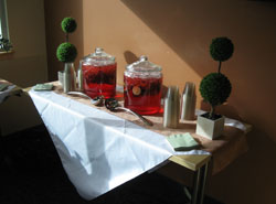 containers of ice tea on a table